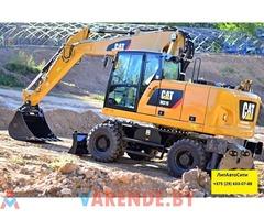 Аренда колёсного экскаватора CAT M318 в Минске